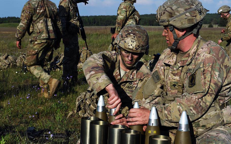 Paratroopers with the 173rd Brigade Combat Team (Airborne) get artillery rounds ready for an artillery live-fire exercise at Grafenwoehr, Germany, Friday, May 18, 2018.