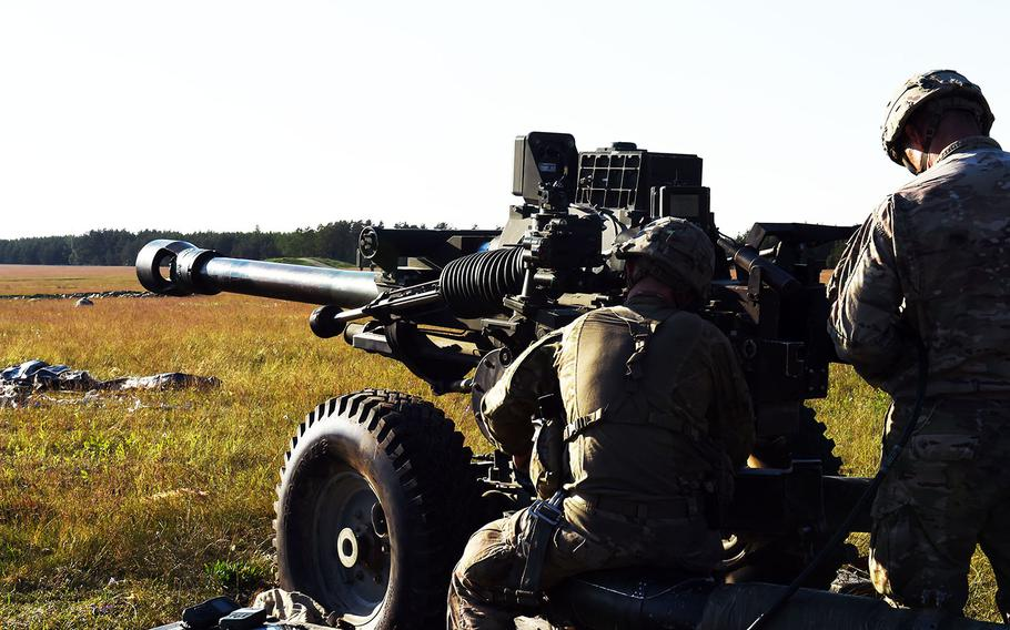 Paratroopers with the 173rd Brigade Combat Team (Airborne) prepare an M119 A3 Howitzer before it is paradropped to the ground during an exercise at Grafenwoehr, Germany, Friday, May 18, 2018.