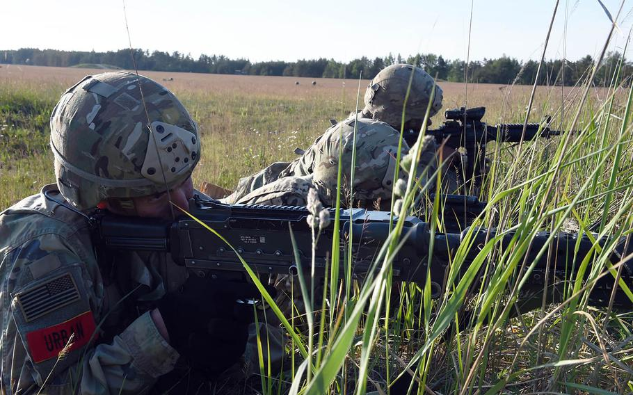 Soldiers with the 173rd Brigade Combat Team (Airborne) provides security during an artillery live-fire exercise at Grafenwoehr, Germany, Friday, May 18, 2018.