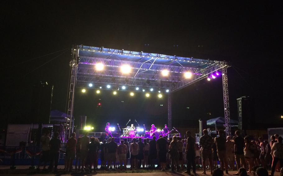 The rock band Fuel entertains troops and their families celebrating Independence Day with fireworks at Yokota Air Base, Japan, on Tuesday,  July 3, 2018.