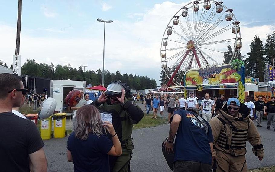 Germans and Americans look at explosive ordnance equipment at the German-American Volksfest at Grafenwoehr, Germany, Friday, August 3, 2018.