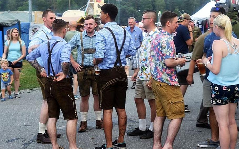 Germans and Americans, some wearing lederhosen, at the German-American Volksfest at Grafenwoehr, Germany, Friday, Aug. 3, 2018.