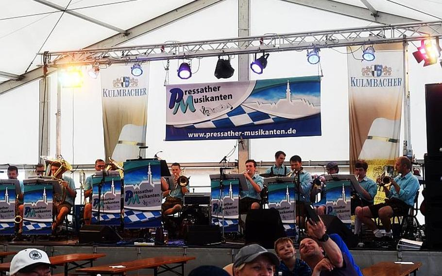 A German brass band plays at the German-American Volksfest at Grafenwoehr, Germany, Friday, Aug. 3, 2018.