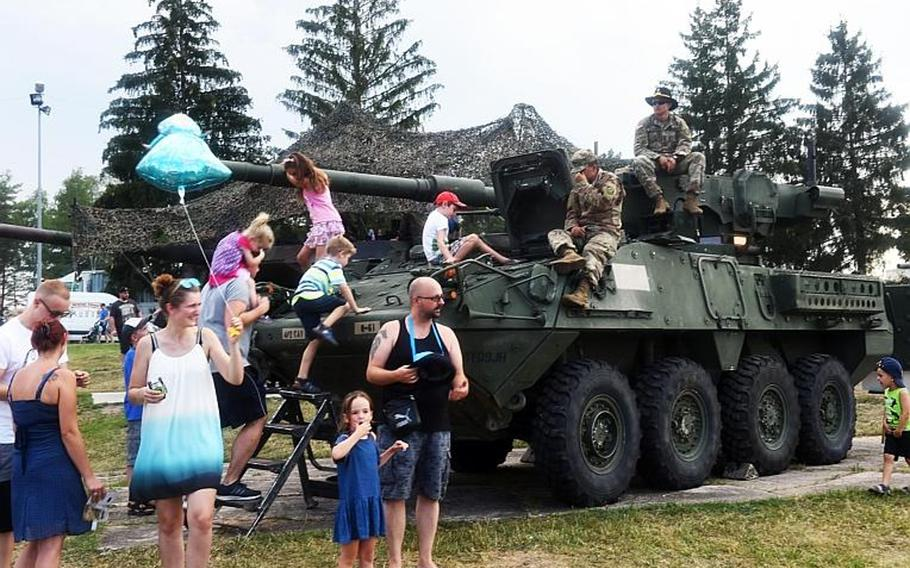 German and American kids climb on a U.S. Army Stryker at the German-American Volksfest at Grafenwoehr, Germany, Friday, Aug. 3, 2018.