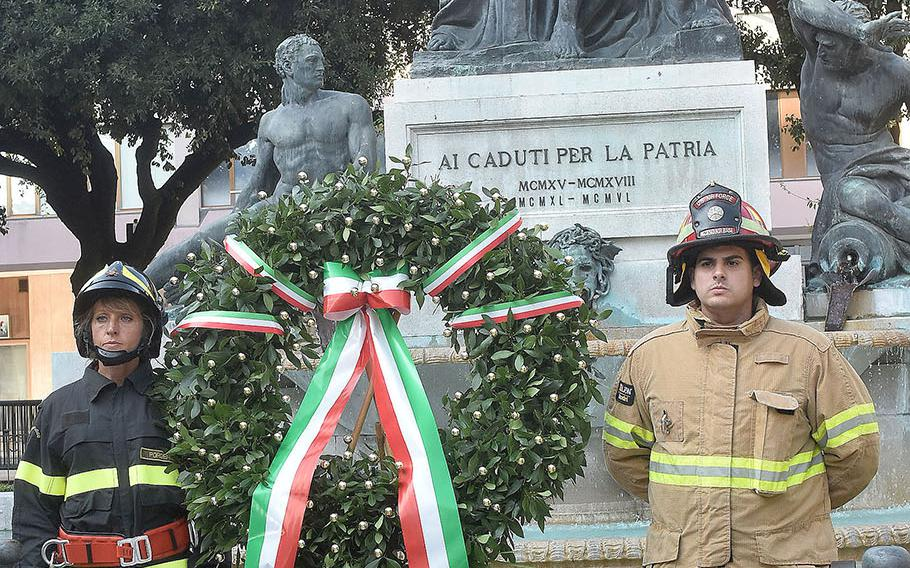 Firefighters with the Vigili del Fuoco of Pordenone, Italy and the 31st Fighter Wing fire department from Aviano Air Base placed a memorial wreath at the Piazza Ellero dei Mille, Pordenone, during the formal opening ceremony of the 17th annual Italian-American Frienship Festival that took place Saturday, Sept. 8, 2018, in the city of Pordenone, Italy.