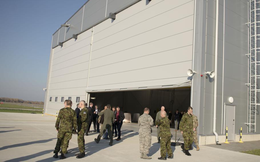 Guests tour the newly constructed aircraft hangar on Estonia's Amari Air Base following a ceremonial ribbon cutting, Oct. 16, 2018.