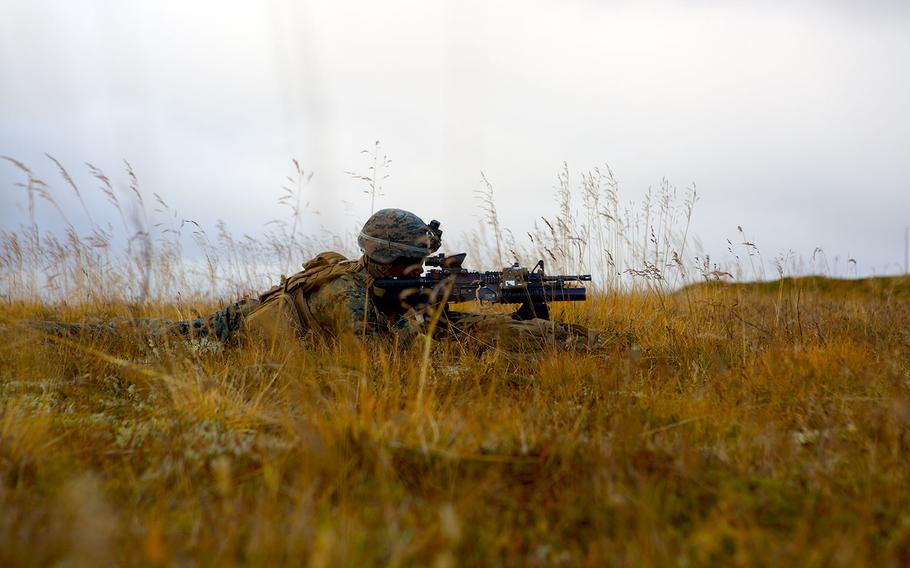 A Marine with 24th Marine Expeditionary Unit posts security at Keflavik Air Base, Iceland, Oct. 17, 2018, during Exercise Trident Juncture 18.