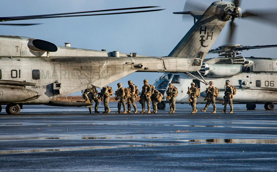 Marines, assigned to the 24th Marine Expeditionary Unit, embark a CH-53 Super Stallion helicopter, during a simulated air assault as part of exercise Trident Juncture 2018 in Keflavik, Iceland, Oct. 17, 2018.