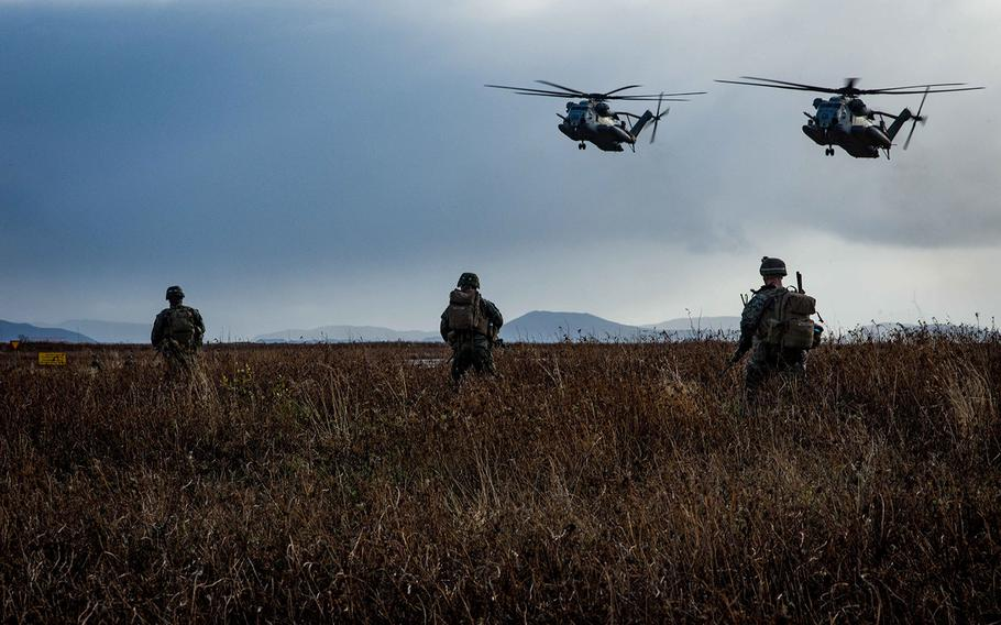 CH-53 Super Stallion helicopters, assigned to the 24th Marine Expeditionary Unit, prepare to retrieve U.S. Marines during a simulated air assault as part of exercise Trident Juncture 2018 in Keflavik, Iceland, Oct. 17, 2018.