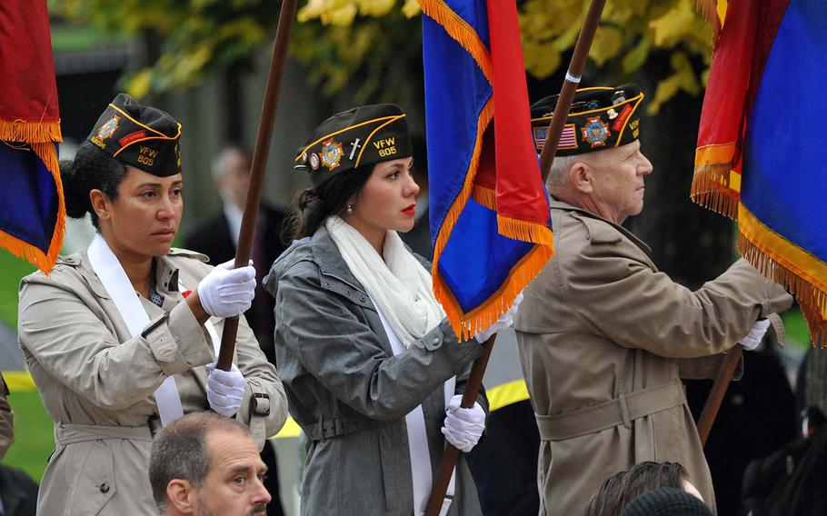 Members of Veterans of Foreign Wars Post 605 present flags during the World War I armistice centennial ceremony, at Suresnes American Cemetery  Sunday, Nov. 11, 2018. Besides marking the anniversary of the armistice, Nov.11 is also Veterans Day in the U.S.
