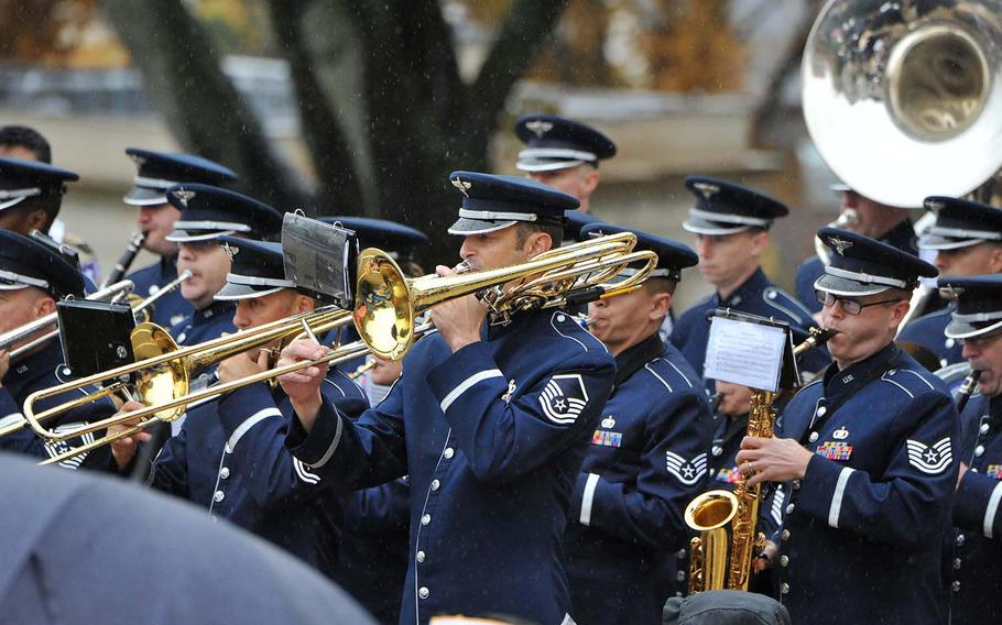 The USAFE Band plays in the rain as they wait for President Donald Trump to arrive at Suresnes American Cemetery on the outskirts of Paris, for a World War I armistice centennial ceremony, Sunday, Nov. 11, 2018.