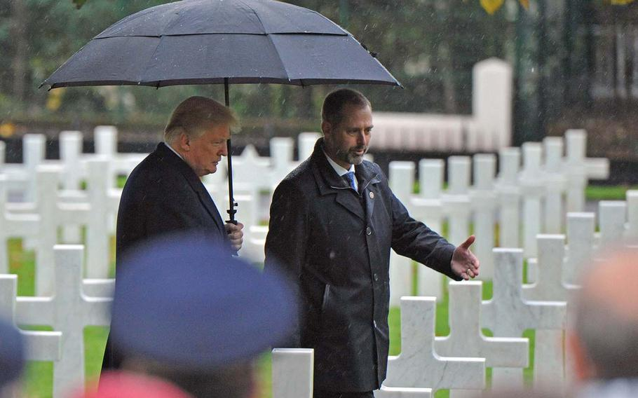 President Donald Trump is shown the World War I graves at Suresnes American Cemetery on the outskirts of Paris, before giving a speech at the World War I armistice centennial ceremony held there, Sunday, Nov. 11, 2018.