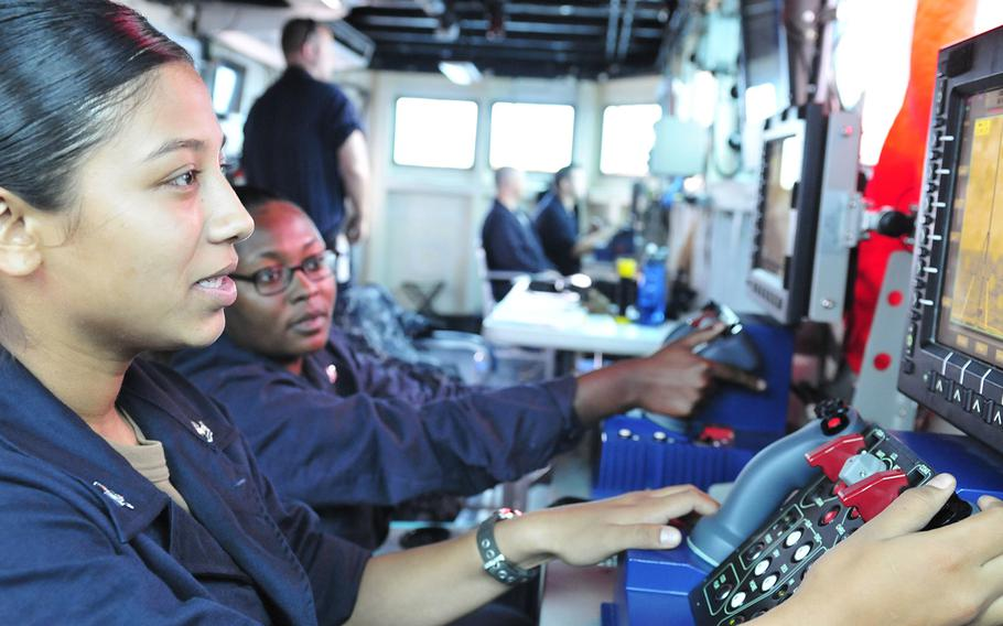 Petty Officers 2nd Class Alma Gallegos, left, and Kjae Robinson, right, assigned to the submarine tender USS Emory S. Land, operate MK-38 weapons systems during the 24th annual Cooperation Afloat Readiness and Training exercises in the South China Sea, Nov. 15, 2018. The Navy will roll out new performance reports which will gather input from subordinates and peers.