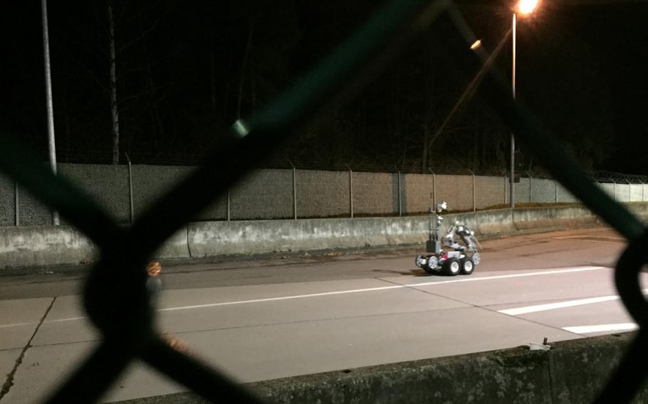 A remotely operated bomb disposal robot prepares to inspect a vehicle driven by a retiree who purportedly made reference to a bomb in his car at Kleber Kaserne, Germany. According to base officials, the 83-year-old Army veteran refused to let security guards do a random search of his vehicle and then made a threat.