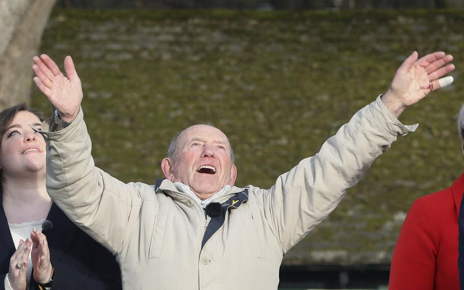 Tony Foulds, 82, waves from Endcliffe Park in Sheffield, as warplanes from Britain and the United States stage a joint flypast tribute to ten US airmen Friday Feb. 22, 2019, 75-years after Foulds witnessed the crash that killed them.
