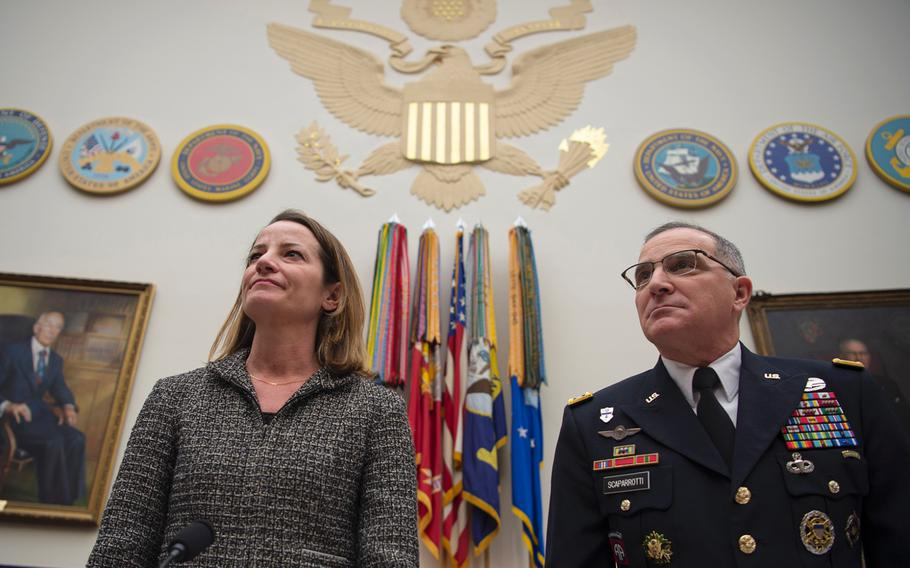 Commander of the U.S. European Command Gen. Curtis Scaparrotti and acting Assistant Secretary of Defense Kathryn Wheelbarger prepare to testify before a House Armed Services Committee hearing on Capitol Hill in Washington on Wednesday, March 13, 2019.
