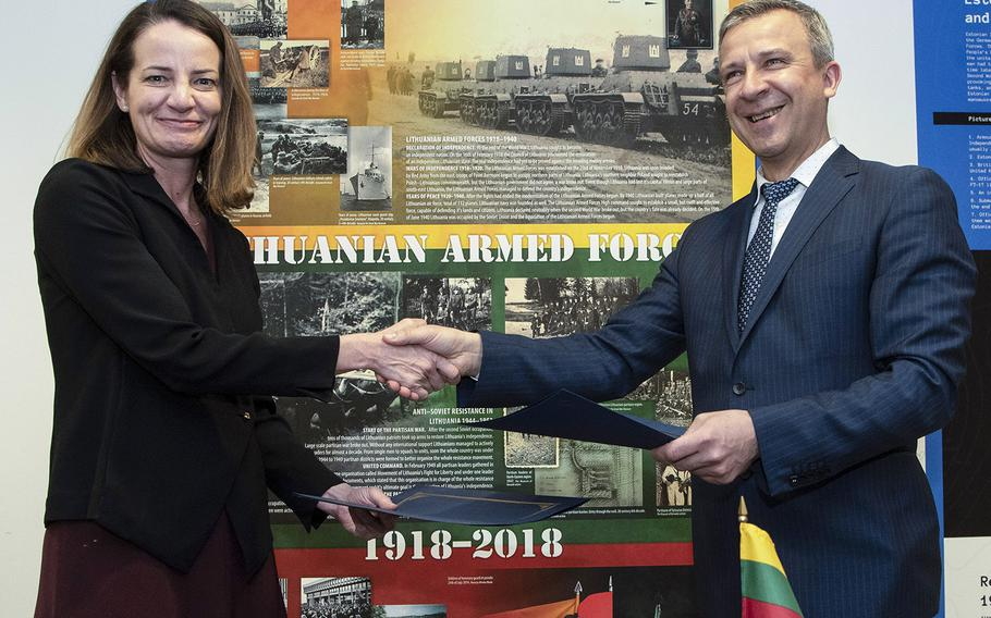 U.S. Acting Assistant Secretary of Defense for International Security Affairs Katherine Wheelbarger and Lithuanian Policy Director Robertas Sapronas pose after signing the U.S-Lithuania Defense Cooperation Strategic Roadmap at the Pentagon, April 2, 2019.