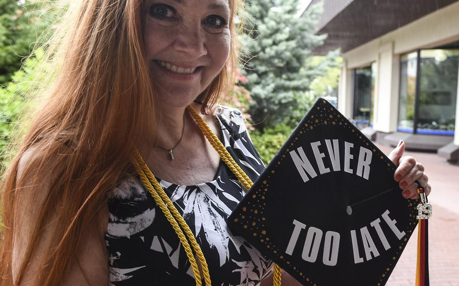 Nicole Sewell displays the motto towards education on her graduation cap at the UMUC Europe commencement on Saturday, May 4, 2019, at Ramstein Air Base, Germany. Sewell received a bachelor's degree in literature and earned the highest GPA of all undergraduates.