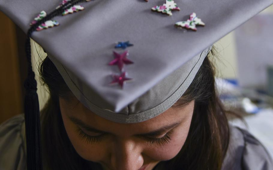 """Jessica Cartagena, 22, decorated her graduation hat with butterflies and stars, since """"this is my time to shine,"""" she said. An Army spouse from Baumholder, Cartagena received her associate's degree in psychology at the UMUC Europe commencement on Saturday, May 4, 2019, at Ramstein Air Base, Germany."""