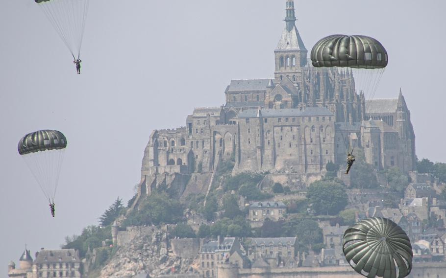 Soldiers assigned to the 10th Special Forces Group (Airborne) conduct an airborne operation near the island of Mont Saint Michel in France on Saturday, May 18, 2019.