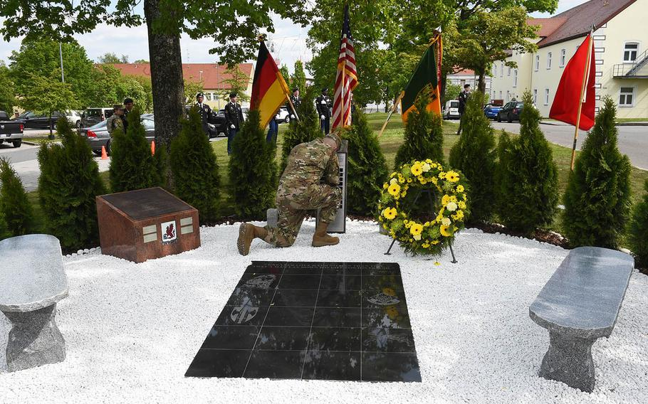Brig. Gen. Christopher Laneve, commander of the 7th Army Training Command, pays his respects to the soldiers who died in combat from the 18th Military Police Brigade, during a ceremony Thursday, May 23, 2019, at Vilseck, Germany.