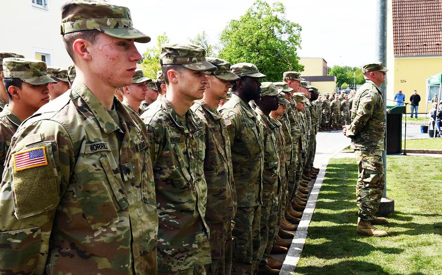 Soldiers with the 18th Military Police Brigade stand in formation during a ceremony to rededicate a memorial to fallen soldiers from their unit, Thursday, May 23, 2019, at Vilseck, Germany.