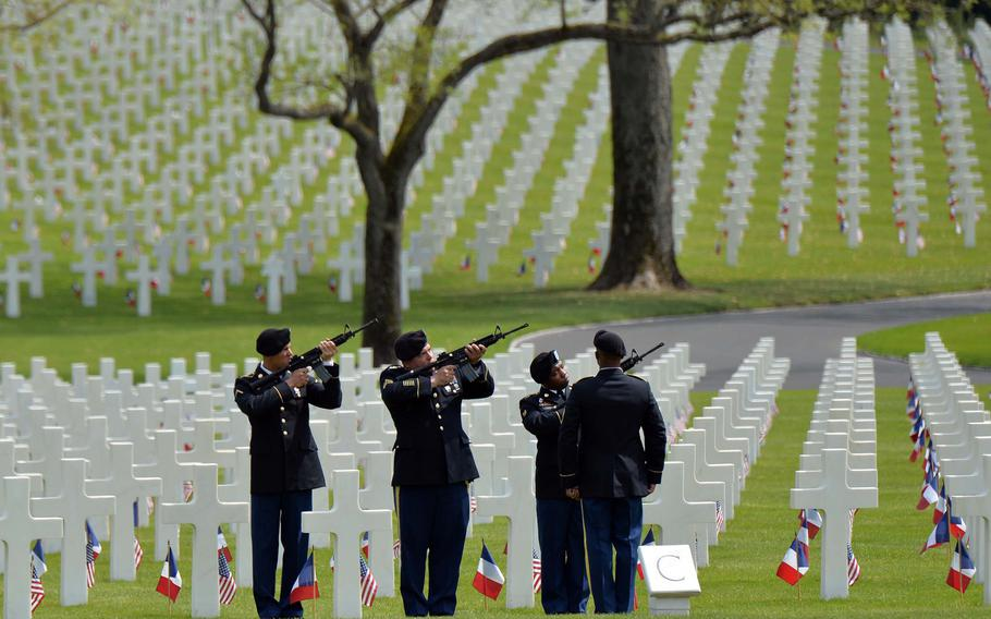 A firing team from the 2nd Cavalry Regiment out of Vilseck, Germany, fires volleys at Memorial Day ceremony at Lorraine American Cemetery in St. Avold, France, Sunday, May 26, 2019. With 10,489 graves, the cemetery is the largest World War II U.S. World War II cemetery in Europe.