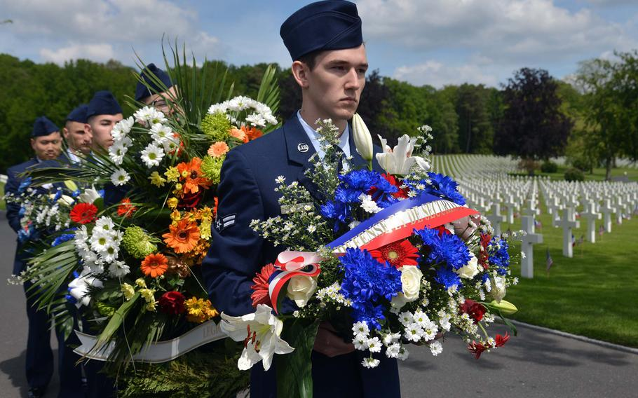 Airmen from Ramstein Air Base, Germany, prepare to present wreaths during the Memorial Day ceremony at Lorraine American Cemetery in St. Avold, France, Sunday, May 26, 2019.