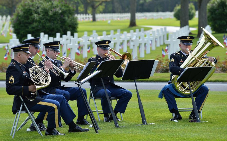 The U.S. Army Europe's brass quintet plays at the Memorial Day ceremony at Lorraine American Cemetery in St. Avold, France, Sunday, May 26, 2019.
