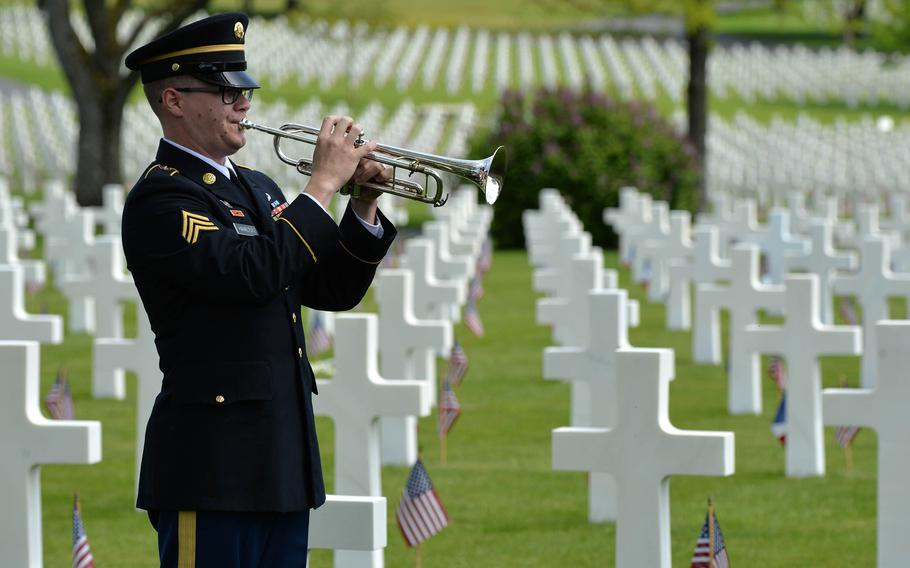 Sgt. William Hamilton of the U.S. Army Europe Band plays a perfect rendition of taps at the conclusion of the Memorial Day ceremony at Lorraine American Cemetery in St. Avold, France, Sunday, May 26, 2019.