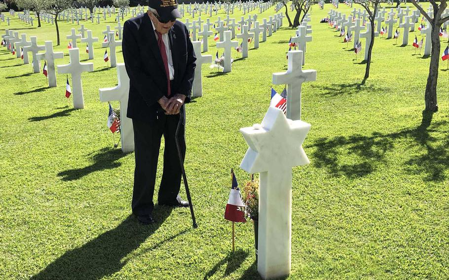On the 75th anniversary of Operation Dragoon, the World War II invasion of southern France, veteran Allan Johnson stands among the graves at Rhone American Cemetery in Draguignan, France, and pays his respects to Pvt. Henry Wikins, a fellow member of the 517th Parachute Regimental Combat Team.