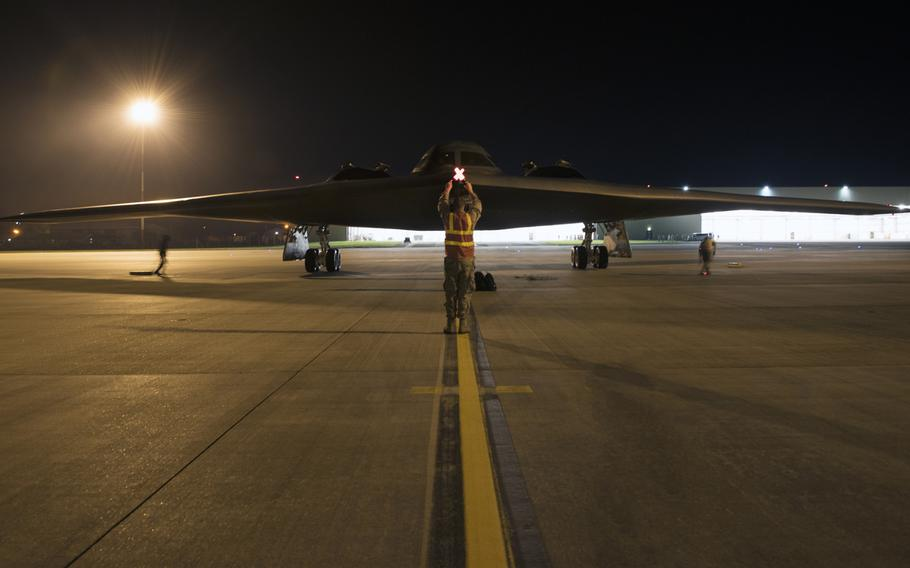 Airman 1st Class Austin Sawchuk, a crew chief assigned to the 509th Bomb Wing, marshals in a B-2 Spirit on the flight line at RAF Fairford, England, on Tuesday, August 27, 2019. B-2 Spirits from Whiteman Air Force Base, Mo., along with equipment and personnel,  arrived at RAF Fairford, England, early Tuesday, to train with allies in Europe.