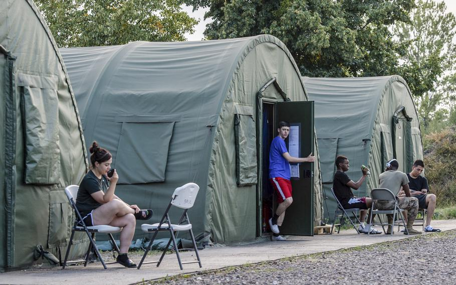 Soldiers relax in a tent city after work on a military base in Powidz, Poland, Aug. 27, 2019. The tent city and an old dorm house almost 1,100 U.S. military personnel on the installation.