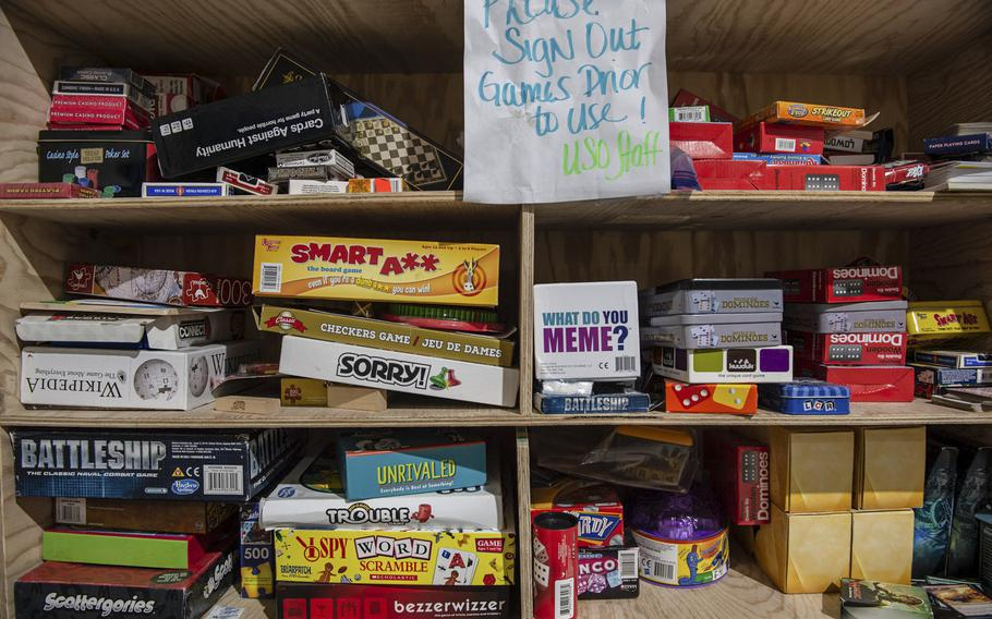 Games fill a bookshelf at the Morale, Welfare and Recreation tent on a military base in Powidz, Poland, Aug. 27, 2019.