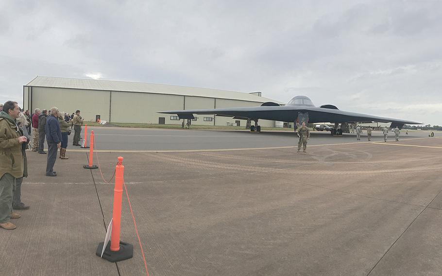 Locals and reporters gather to take photos of the B-2 bomber temporarily stationed at RAF Fairford, England, on Friday, Sept. 7, 2019.