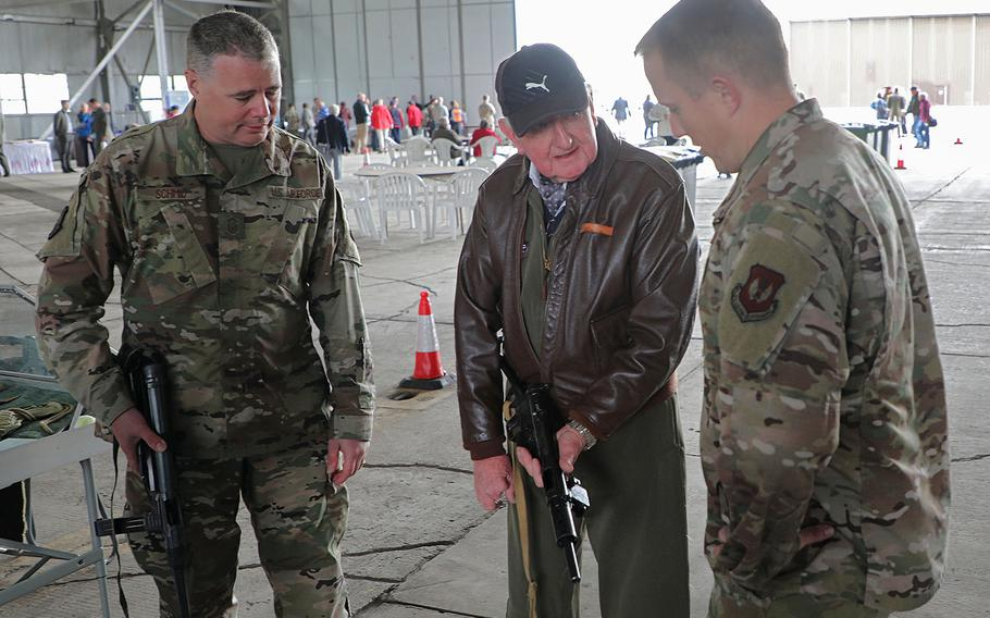 Local Bill King, center,  explains World War II weapons to Sr. Master Sgt. Casey Schmid, left, and Maj. Ken French on Friday, Sept. 6, 2019, during the 75th Anniversary Heritage Day on RAF Fairford, England.