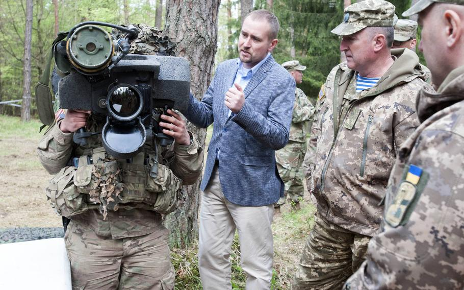 A soldier demonstrates how to use the Javelin anti-tank missile system to a delegation of senior Ukrainian military  officials at the Hohenfels Training Area, Germany in 2017. Seven Democratic Senators sent a letter Wednesday to DOD's Inspector General, seeking a review into the role the Pentagon played in delaying funds for Ukraine that were intended to help it in a nearly six-year-old fight against Russian-backed separatistst.