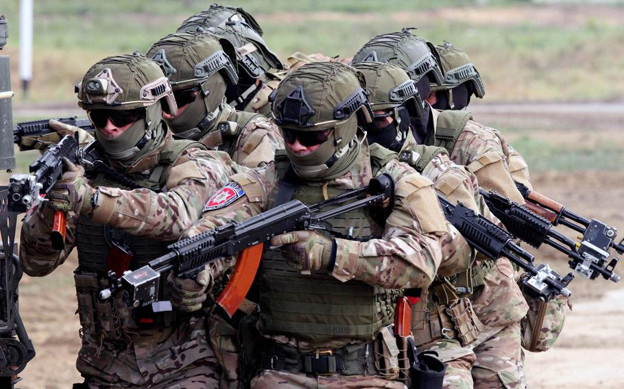 A Ukrainian special forces team moves in unison and prepares to rescue a hostage Sept. 20 during the multinational Rapid Trident exercise involving NATO and Ukrainian troops in Sept. 2019 in Yavoriv, Ukraine.