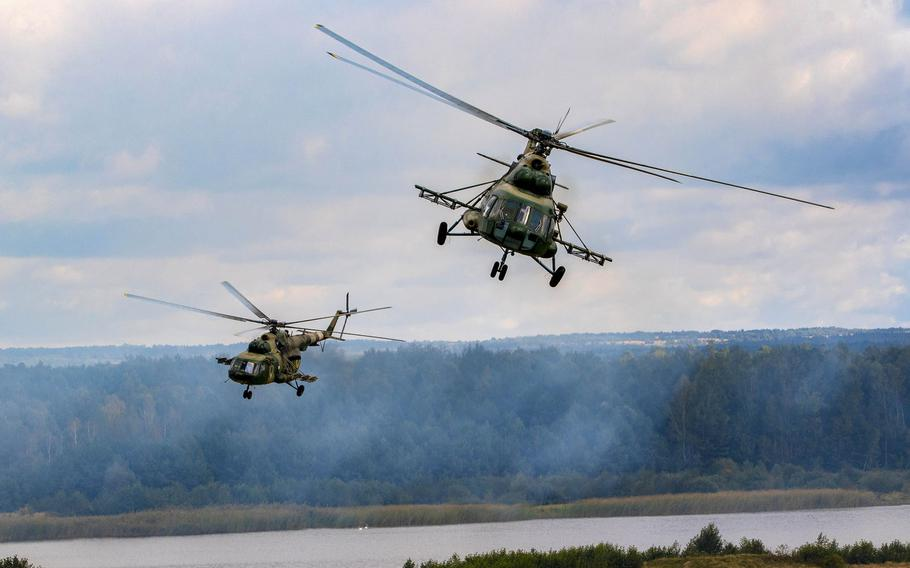 Ukrainian helicopters provide aerial support during a wet gap crossing demonstration as part of Rapid Trident 2019, Sept. 20, 2019, near Yavoriv, Ukraine.
