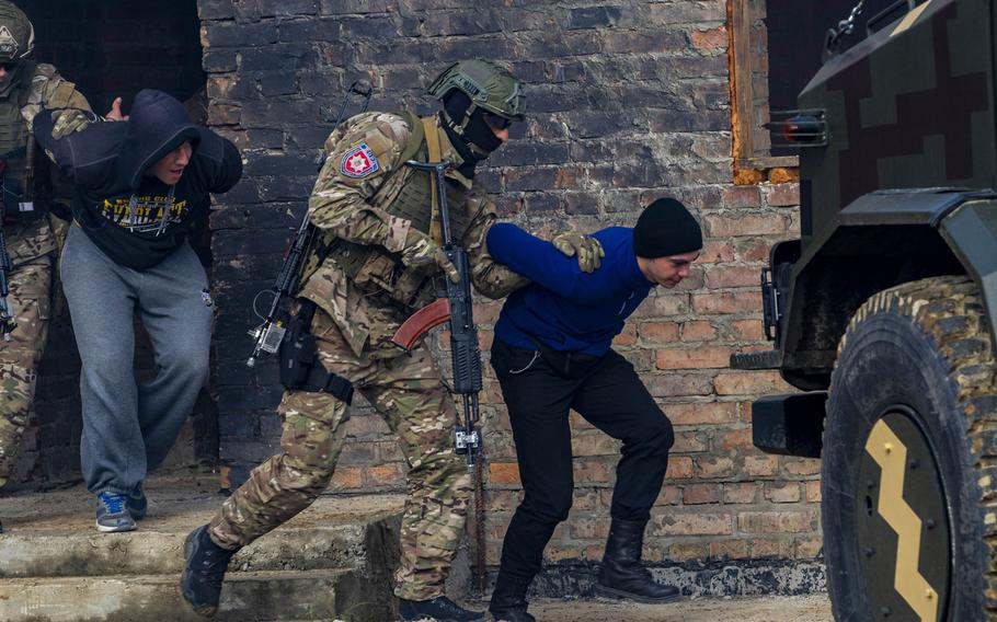 Ukrainian soldiers detain simulated enemy forces during a fire team movement and room-clearing demonstration as part of Rapid Trident 2019, Sept. 20, 2019, near Yavoriv, Ukraine.