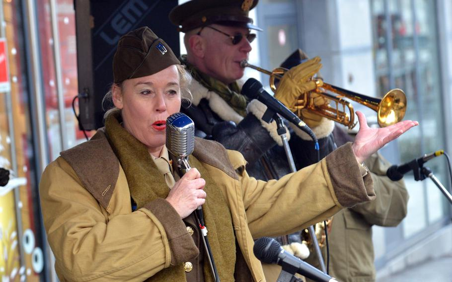 Band members dressed in World War II-era garb entertain with music from the era on the streets of Bastogne, Belgium, as the city and the surrounding areas mark the 75th anniversary of the Battle of the Bulge on Saturday, Dec. 14, 2019.