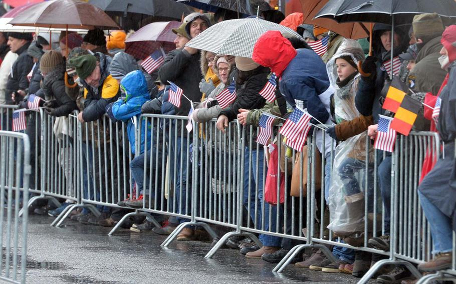 Spectators, many with American flags, line the main street of Bastogne, Belgium, as the parade marking the 75th anniversary of the World War II Battle of the Bulge begins, Saturday, Dec. 14, 2019.