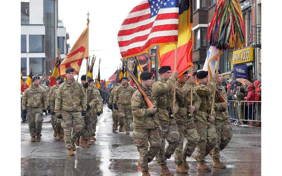 An American color guard followed by service members of the U.S. Army Garrison Benelux march through Bastogne, Belgium, Saturday, Dec. 14, 2019. The eastern Belgian town was marking the 75th anniversary of the Battle of the Bulge.