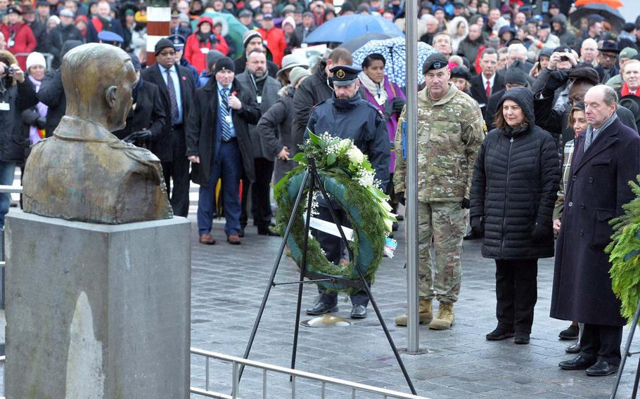 The American delegation that included Speaker of the House Nancy Pelosi, second from right, and 101st Airborne Division commander Maj. Gen. Brian Winski, second from left, lay a wreath at the monument to Gen. Anthony McAuliffe at the square named after him in Bastogne, Belgium. The ceremony was part of the celebrations marking the 75th anniversary of the Battle of the Bulge.