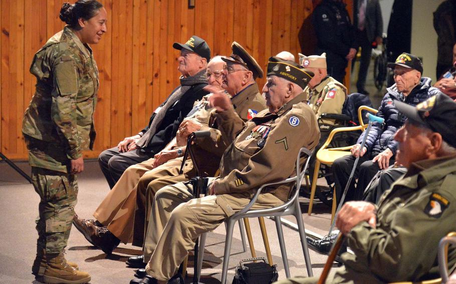 A soldier talks to Battle of the Bulge veterans before a ceremony marking the 75th anniversary of the bloody World War II battle. More than 30 veterans turned up for the event.