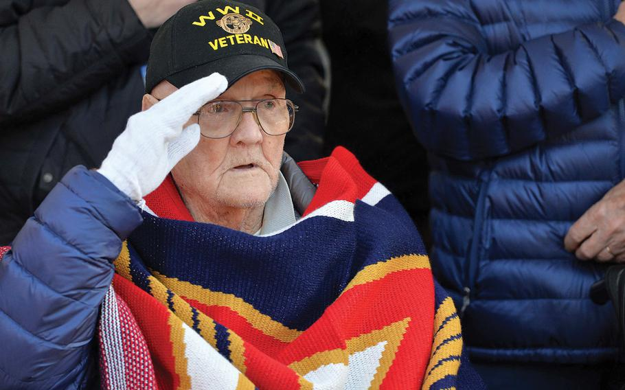 World War II veteran Francis X. Murphy sings and salutes during the playing of the national anthem at the conclusion of a 75th anniversary of the Battle of the Bulge ceremony at the 106th Infantry Division monument in St. Vith, Belgium, on Sunday, Dec. 15, 2019.