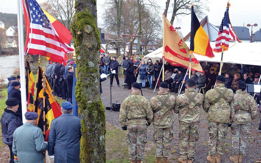 A monument to World War II prisoners of war was dedicated, Sunday, Dec. 15, 2019, during a ceremony on the banks of the Our River in the St. Vith, Belgium, district of Schoenberg.