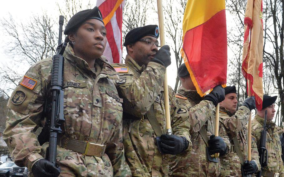 A U.S. Garrison Benelux color guard marches in the colors at the beginning of a ceremony in the St. Vith, Belgium, district of Schoenberg, where a monument to World War II prisoners of war and missing in action was dedicated Sunday, Dec. 15, 2019.