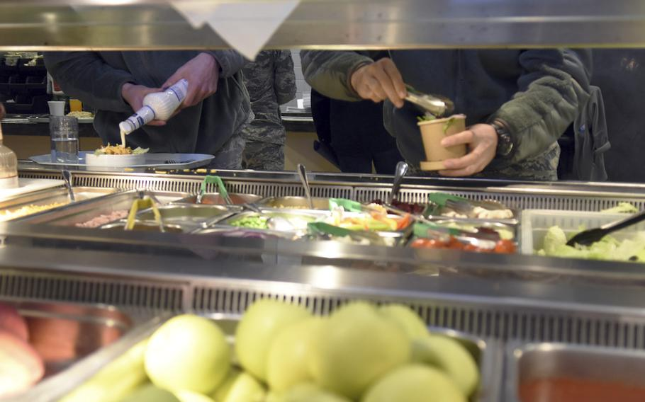 Airmen load up on veggies at the salad bar at the Rheinland Dining Facility at Ramstein Air Base, Germany, on Tuesday, Dec. 17, 2019. Most airmen who live on Ramstein will receive  extra in their paychecks after the dining facility closes next month for a renovation project.