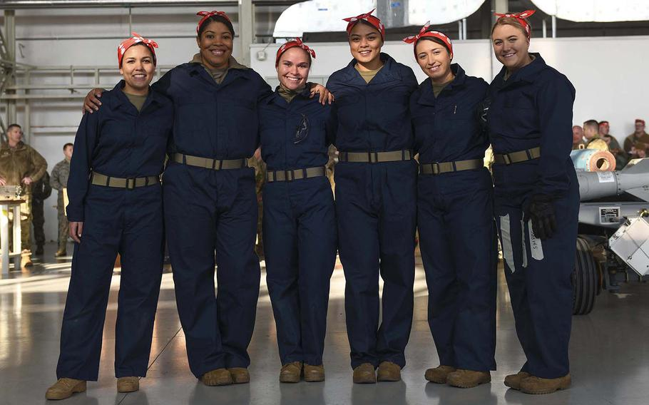From left, U.S. Air Force Staff. Sgt. Ana Merkel, Staff Sgt. Catharyn Clyde, Staff Sgt. Nicole Jarvis, Senior Airman Audrey Naputi, Airman 1st Class Ashlyn Martin and Airman Erin Brumm pose at Aviano Air Base, Italy, Jan. 7, 2020. The team members dressed as Rosie the Riveter to represent women who worked in factories and shipyards, producing munitions and war supplies during World War II.